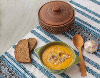 Pumpkin soup with fried onions and meat with bacon Stock Photography