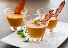 Pumpkin soup in glasses Stock Image