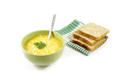 Pumpkin soup with grated cheese and sliced bread Stock Photos