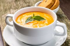 Pumpkin soup with green basil Royalty Free Stock Photography
