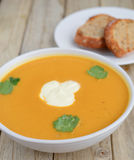 Pumpkin soup with home made bread royalty free stock image