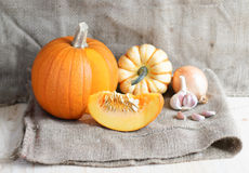 Pumpkin soup ingredients (pumpkins, garlic, onion) on a sack Stock Photo