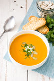 Pumpkin soup and ingredients on white wooden background Royalty Free Stock Photography