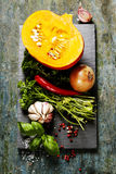 Pumpkin soup ingredients on wooden background Stock Photography