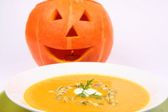 Pumpkin soup and Jack-o'-lantern Royalty Free Stock Photo