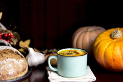 Pumpkin soup in a mug Royalty Free Stock Photo