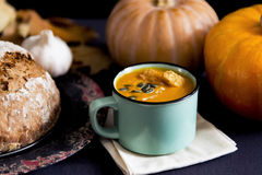 Pumpkin soup in a mug Stock Photography