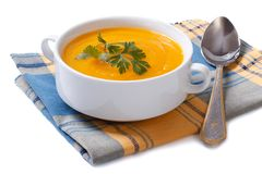 Pumpkin soup on a napkin isolated Stock Images