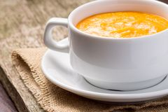 Pumpkin soup at old wood plank Stock Image