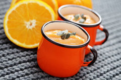 Pumpkin soup with orange Stock Image