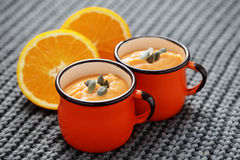 Pumpkin soup with orange Stock Photos