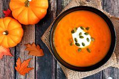 Pumpkin soup overhead scene on rustic wood Royalty Free Stock Photography