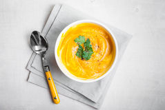 Pumpkin soup with parsley background Royalty Free Stock Images