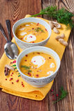 Pumpkin soup with peanuts on a wooden table Stock Photos