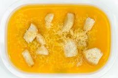 Pumpkin soup in plastic box Stock Photos