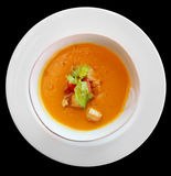 Pumpkin soup in plate shot from above, isolated Royalty Free Stock Photography