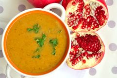 Pumpkin soup and pomegranate fruit Stock Image