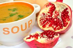 Pumpkin soup and pomegranate fruit Royalty Free Stock Photo