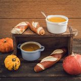 Pumpkin soup and pretzel sticks Stock Photo