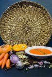Pumpkin soup and pumpkin with autumn vegetables garlic, carrots, onion, spices, seeds. Autumn mood. royalty free stock image