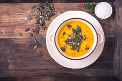 Pumpkin soup with pumpkin seeds and chili peppers stock photos