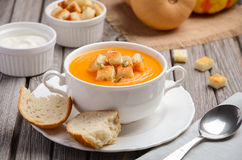Pumpkin soup with pumpkin seeds and croutons Royalty Free Stock Images