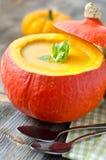 Pumpkin soup in a pumpkin. Pumpkin soup selective focus wooden background Stock Photo