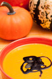 Pumpkin soup with pumpkins Royalty Free Stock Photography