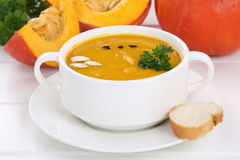 Pumpkin soup with pumpkins in bowl Stock Photo