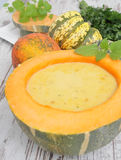 Pumpkin soup. With pumpkins on a table Royalty Free Stock Photo