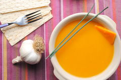 Pumpkin soup on purple clothtable Royalty Free Stock Photos