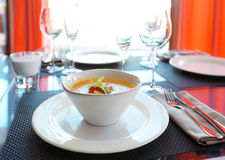 Pumpkin soup on restaurant table Royalty Free Stock Photography