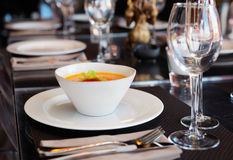 Pumpkin soup on restaurant table Royalty Free Stock Photo