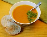 Pumpkin soup with the roasted bread. Hot vegetarian soup in a plate with the roasted bread and parsley Royalty Free Stock Photography