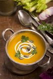 Pumpkin soup on rustic wooden background Stock Photo