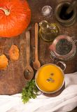 Pumpkin soup on rustic wooden background Royalty Free Stock Images