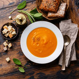 Pumpkin soup with sage. And Croutons on wooden background Stock Photo