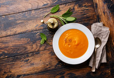 Pumpkin soup with sage. On wooden background Copy space Royalty Free Stock Images
