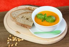 Pumpkin soup and seeds with bread Stock Images