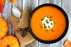 Pumpkin soup with seeds and cream, above scene on wood Stock Photography