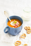Pumpkin soup served in blue ceramic mug with cream and paprika Stock Images