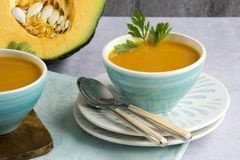 Pumpkin soup served in a bowl stock images