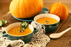 Pumpkin soup served in a ceramic plate, decorated with pumpkin s. Eeds stock images