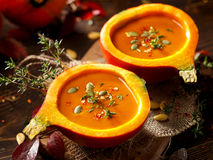 Pumpkin soup served in a hollowed pumpkins stock photos
