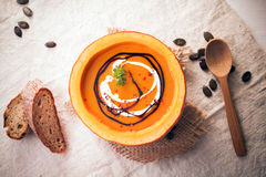 Pumpkin soup served in the rind Royalty Free Stock Photography