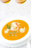 Pumpkin soup with shrimp, Parmesan and rosemary and two glasses Stock Image