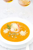Pumpkin soup with shrimp, Parmesan and rosemary and two glasses Stock Photos