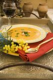 Pumpkin soup on silver plate. Sweet and creamy pumpkin soup in warm colorful display Stock Photo