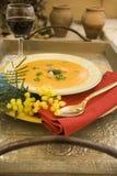 Pumpkin soup on silver plate Stock Photo