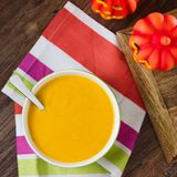 Pumpkin soup. Simple plain creamy pumpkin soup. Homemade seasonal food with halloween decoration Royalty Free Stock Photo